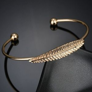 gold bangle open leaf brac
